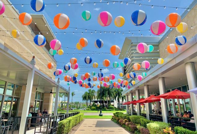 beach balls handing over a walkway at the Mall at UTC