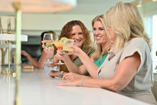 Women drinking cocktails at Drift Kitchen on Lido Key