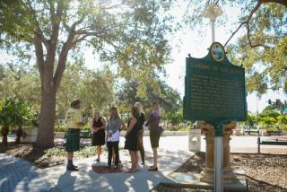 tour group standing near a historical marker in sarasota florida