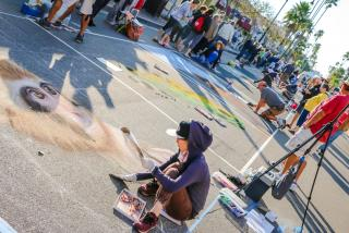 artists working on chalk paintings in Venice Florida