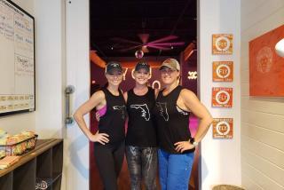women posing at workout facility in sarasota florida