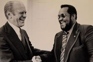 president gerald ford shakes hands with dr. ed james in sarasota florida