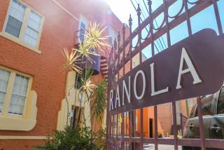 Sign and exterior of hotel ranola in sarasota florida