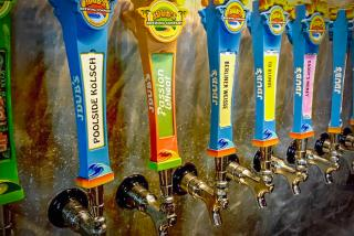 Beer taps along the wall at JDub's Brewing Co. in Sarasota