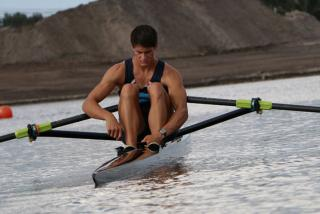 Travis Taafe rowing at Nathan Benderson Park.  Photo credit: Eddie Kirsch.