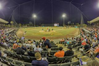 night spring training baseball game at ed smith stadium