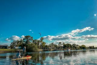 people on stand up paddleboards in north port florida