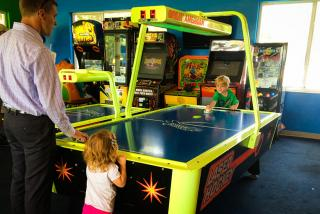 Air hockey fun at Evie's in Sarasota County. Photo by Liz Sandburg
