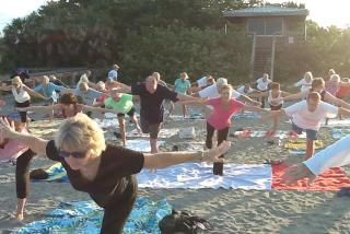 Siesta Beach Yoga. Photo courtesy of Yoga With Elin.