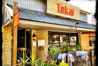 sidewalk view of tokaj restaurant in sarasota florida during the day