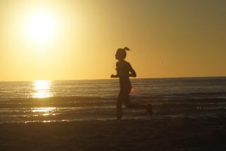 Running On The Beach. Photo credit: Robin Draper.