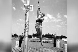woman posing on a dock in 1962