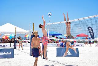 Teams playing beach volleyball on siesta key