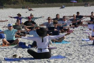 Yoga on the Beach. Photo credit: Robin Draper.