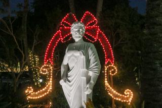 statue in st. armands circle with holiday lights behind it