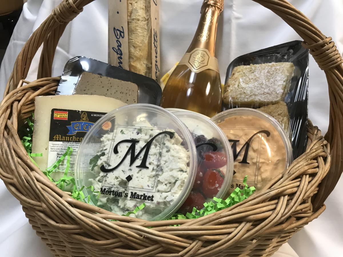 picnic basket filled with items from mortons gourmet market in sarasota florida