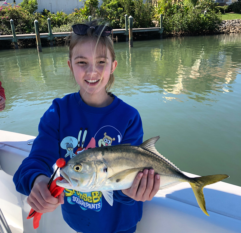 Twelve year old Skylar Henry of Lincoln, Nebraska with one of several large jack cravalle she caught this week