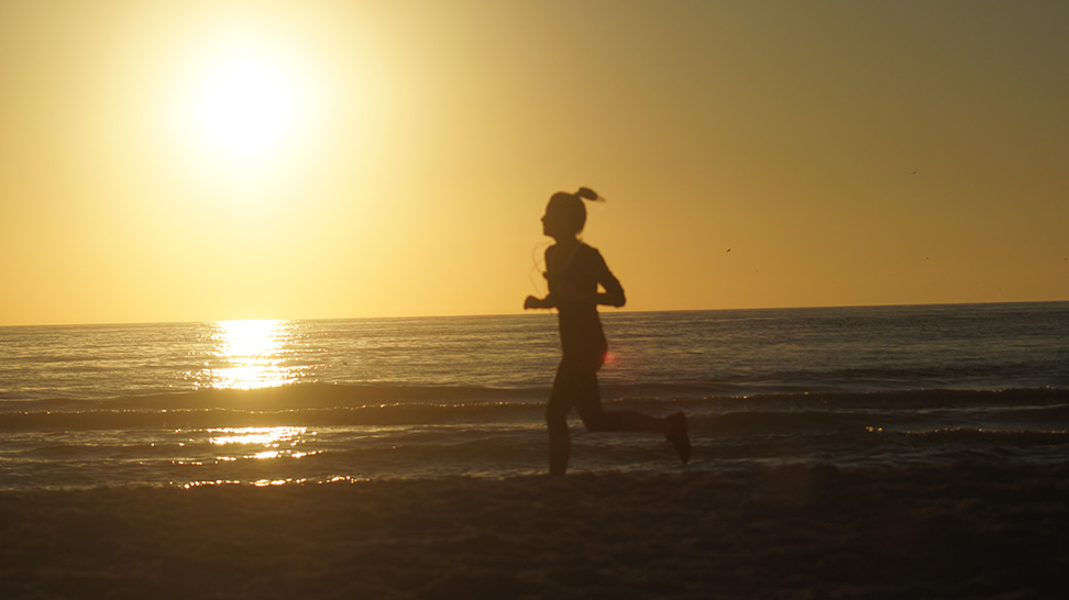 Running on the on Siesta Beach at Dusk can be a beautiful way to burn calories