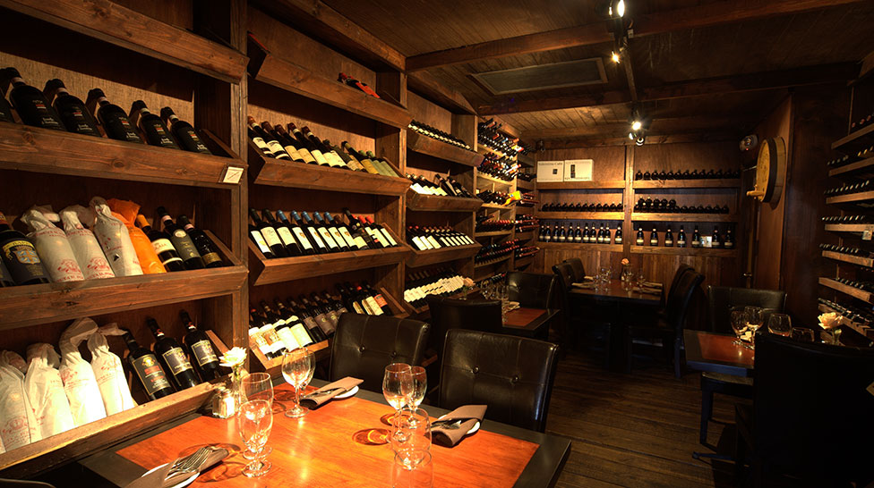 Custom wine cellar and seating at Café Gabbiano