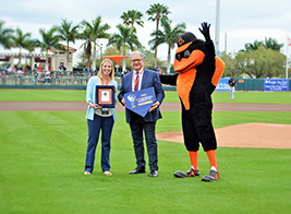 VSC Sports Sales Director Shelby Connett and WBSC President Riccardo Fraccari following the announcement at an Orioles Spring Training game.