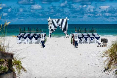 Nautical Tide Wedding Package - Crisp Siesta Key Beach White Sand accented with our traditional Navy & White Sailor Theme!