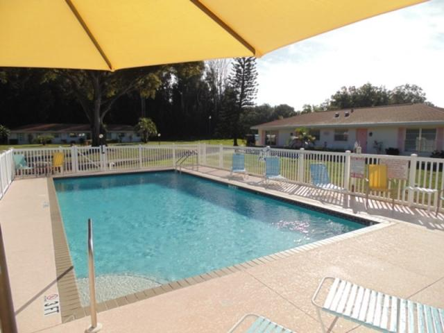 Pool Looking East - Addy's Villas pool is heated in the winter and always offers plenty of Florida Sunshine.