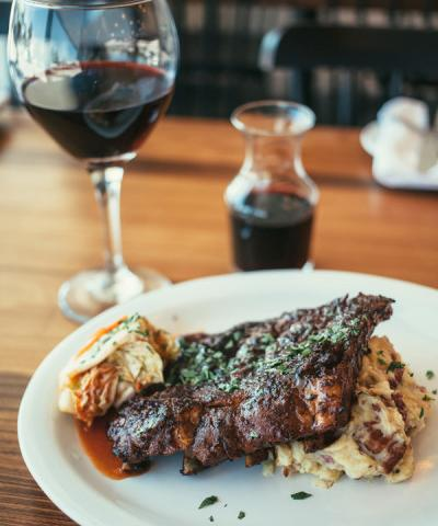 KOREAN STYLE BBQ RIBS - pork ribs basted with korean bbq sauce, kim chi, bacon & brussel mashed potatoes