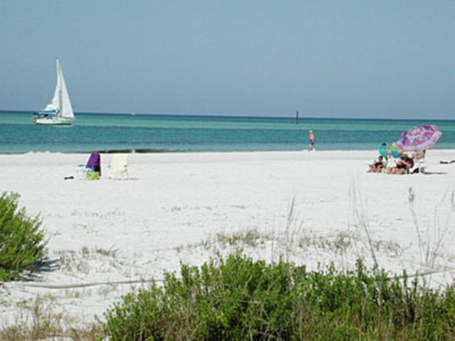 """Siesta Key Beach - The biggest attraction on Siesta Key, Florida is the three mile long white Siesta Beach. This wonderful powder white sand beach, with its 99% pure quartz energy, is perfect for a brisk run or a little stroll. Either one is rejuvenating and healing. Siesta Beach is one of the top ranked vacation beaches in the state of Florida and Worldwide. ?Siesta Beach (Sarasota, Florida) was Voted America's Best Beach in 2017 by Dr. Stephen P. """"Dr. Beach"""" Leatherman and also voted America's No. 1 Beach by Trip Advisor in 2017. ?Additional accolades include """"Best Beach in America"""" by The Travel Channel in 2004 and the """"World's Whitest, Finest Sand Beach"""" at the International Sand Contest in 1987."""