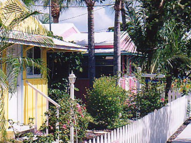 Yellow Palm & Pink Mango Cottages