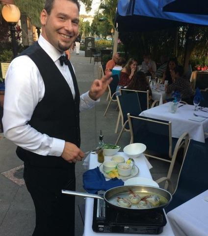 Tableside delights - One of our specialty features is a tableside preparation for select dishes. Pictured here is Brian, expertly preparing tableside Shrimp Pernod for a table of patio-diners.