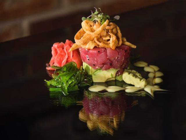 Tuna Tartare - Chef Rolando's Tuna Tartare is prepared with the freshest possible sushi-grade tuna, a sweet-and-spicy combination of soy and wasabi sauces, and wakame salad.