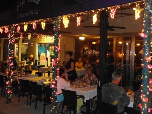 2975_640x480.jpg - Evening outdoor dining with charming grape lighting on our sidewalk terrace
