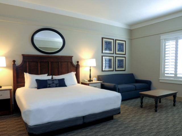 Standard King Room - Enjoy cozy beds, handcrafted details, quilts and one-of-a-kind décor. Standard King rooms include; 1 King Bed, 1 Sofa Bed, separate dressing area with a sink, walk-in shower and a dining table with 2 chairs.