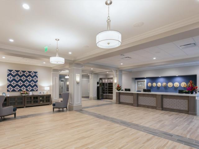 Warm and Inviting - Integrating pieces of Amish Heritage and a soothing atmosphere, we welcome you through the doors of Carlisle Inn Sarasota to our cozy lobby.