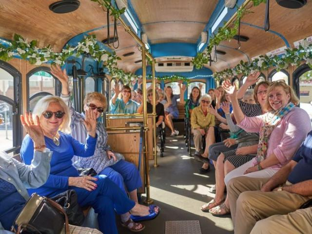 Trolley Tour goers enjoy learning about Sarasota Architecture and historic neighborhoods - Weekly Architectural Trolley Tours