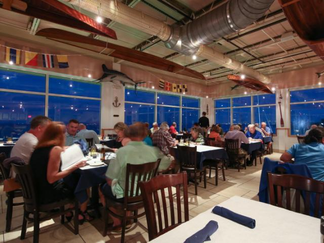 Indoor & upstairs dining features panoramic views of Sarasota Bay
