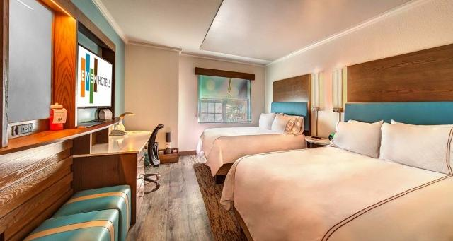 2 queen bedded rooms featuring fitness equipment in each room