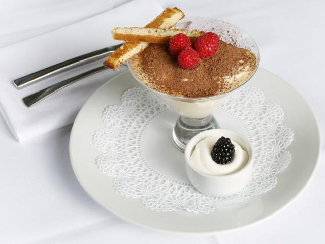 TIRAMISÚ - Espresso-infused Sponge Cake layered with clouds of Mascarpone Cheese & dusted with Cocoa Powder.