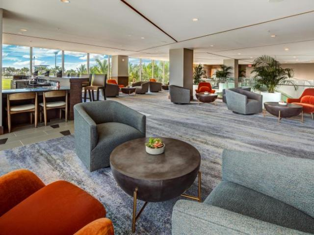Icon Loft - Enjoy the relaxing ambiance of the upstairs Icon Loft area, complete with a bar, and intimate seating areas.
