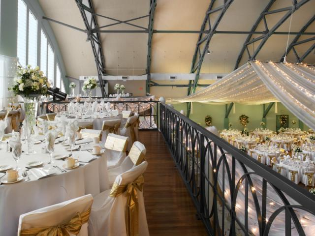 Wedding Balcony View - The tall ceilings and stunning hardwood floors create an elegant aesthetic while enhancing the quality of acoustics.