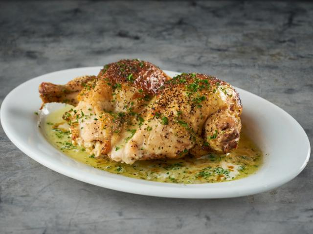 Stuffed Chicken Breast - Stuffed with garlic herb cheese on a sizzling plate