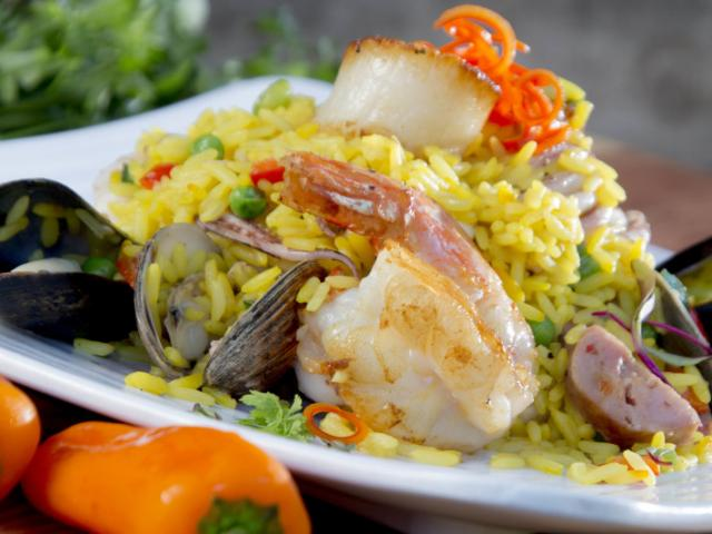 SKOB Entree - Seafood Paella is Chef Gino's featured entree.  Enjoy Mussels, Clams, Scallops, Shrimp and Calamari with Chorizo and Saffron Infused Rice