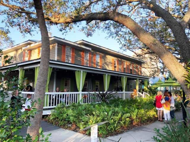 Towles Art Center Porch - Three restaurants at Towles! Bodhi Tree Cafe (here on the porch of the Art Center) Shoogie Boogie Garden Cafe (on the courtyard) and Indigenous (located at Links and Adams)
