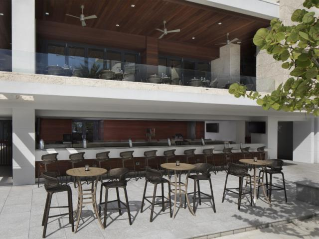 Cascades Pool Bar - Savor light bites and sip on cocktails at our bar overlooking the pool