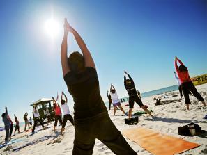 Group of women doing yoga on the beach in Sarasota