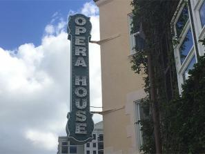 "Downtown Sarasota - Opera House - The Sarasota Opera House (originally the Edwards Theatre) [2] is an historic theatre, now opera house, located at 61 North Pineapple Avenue in Sarasota, Florida. The vision of a local man, A. B. Edwards. It originally opened on April 10, 1926 with an elaborate three-story entrance containing ""eight shops on the ground floor, 12 offices on the second floor, and 12 furnished apartments on the third, while the theatre's auditorium contained an orchestral pipe organ. As noted on the Sarasota Opera's website, the Sarasota Herald Tribune hailed Edwards for ""having admitted Sarasota into a fairyland of costly decoration, rich furnishings and never to be forgotten artistry."" The building was designed by Roy A. Benjamin in the Mediterranean Revival Style Architecture[4] and constructed by the GA Miller Construction Company. The theatre is now the home of the Sarasota Opera Association, Inc., which owns the building. The Association is the parent body which runs the Sarasota Opera. The house now seats 1,119."