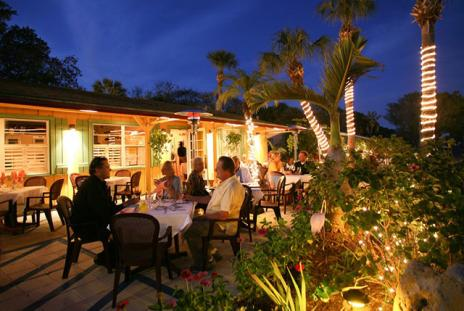 People eating outside at night at Harry's continental kitchens restaurant in sarasota florida
