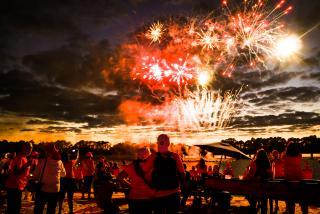 People watching fireworks at nathan benderson park in sarasota florida
