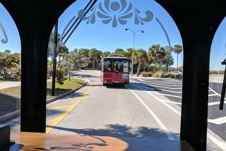 Trolley riders on Lido Key, approaching the public beach entrance