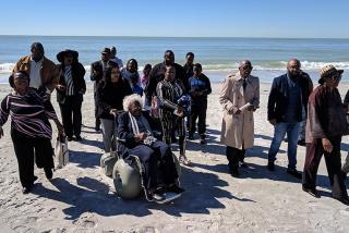 Living members of the original beach caravans and their families return to Lido Beach